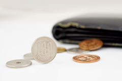 Money Shortage. Japanese Yen coin out of old purse to convey meaning money shortage Stock Photography