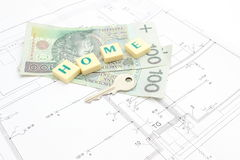 Money and silver key on housing plan Stock Images