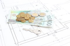 Money and silver key lying on the housing plan Stock Image