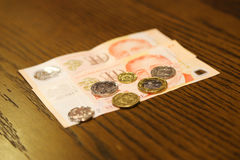Money Singapore on the wooden for the trip to Singapore Stock Images