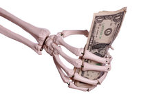 Money in skeleton hand royalty free stock photo