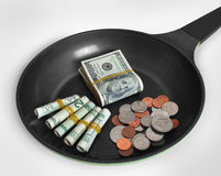 Money in skillet Stock Images