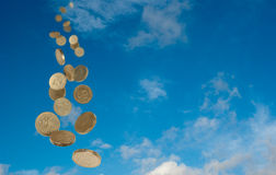 Money from the sky. Pound coins falling from the sky with space for text Royalty Free Stock Photos