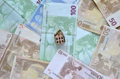 Money and a small house Royalty Free Stock Photo