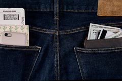 Money, Smart, Debit card and Credit card are in pocket of blue jean. One hundred dollar bills and cards in back of jean pocket in concept of business and Royalty Free Stock Image