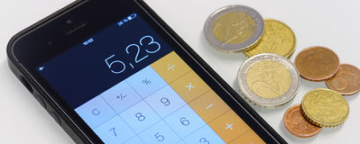 Money and smartphone calculator Royalty Free Stock Photos