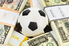 Money and soccer ball Royalty Free Stock Photos