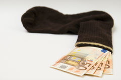 Money in a sock Stock Photography