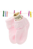 Money in sock on laundry line Royalty Free Stock Photography