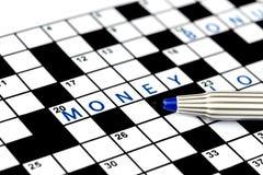 Money in solving crossword puzzle Stock Image
