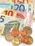 Money. Some euro banknotes and coins are spread Stock Photography