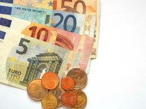 Money. Some euro banknotes and coins are spread Stock Image