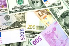 Money, some more money. Background made from euro and dollar bancknotes stock photography