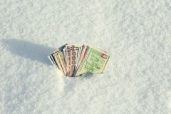 Money of south-east Asia in the snow in the winter. Currency of Hong Kong, Indonesia, Malaysia, China, Thai. Royalty Free Stock Photos