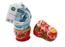 Money and souvenir. Paper money in the wooden toy Royalty Free Stock Images