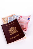 Money in the Spanish passport Royalty Free Stock Photography