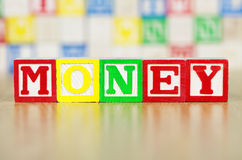 Money Spelled Out in Alphabet Building Blocks Stock Photography