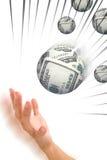 Money sphere in hand Stock Images
