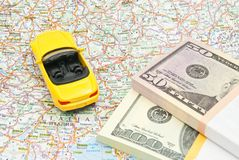 Money and sport car on map Stock Image
