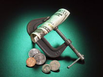 Money squeeze. As a metaphor for inflation and increase in taxes Stock Images