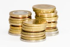 Money stack. A money stack of coins ( euros ) isolated on white royalty free stock images
