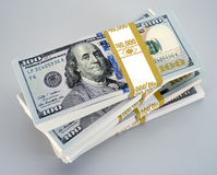 Money stack. With new bills on grey white Royalty Free Stock Image