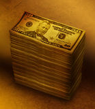 Money Stack Pile on Brown Background. A stack of fifty dollar bills on a brown gold texture background. There is dark shadows on the money. Use it for a economic Stock Photography