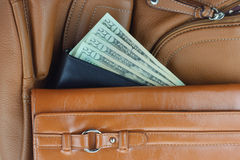 Money between stack of purses. Four twenty dollar bills between leather purses Royalty Free Stock Photography