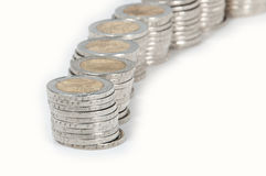 Money stacks. Consisting of 2-Euro coins isolated on a white background royalty free stock photos