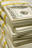 Money Stacks. Stacks of $100 bills banded in $10,000 amounts with a yellow band Royalty Free Stock Photos