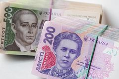 Money stacks. Stacks of two and five hundred hryvnia bills royalty free stock photo