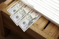 Money stashed under mattress Stock Images
