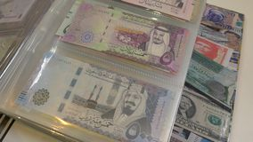 Money of state banknotes Afghanistan and Bahrain. Numismatic collector - collecting money stock video footage