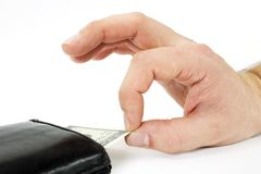 Money stealing. A hand taking money out of vallet stock photography