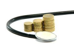 Money and stethoscope Stock Photo