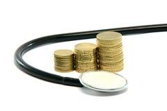 Money and stethoscope Stock Photo