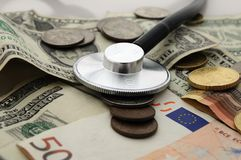 Money and Stethoscope Royalty Free Stock Image