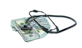 Money and stethoscope. Isolated on white background Stock Image