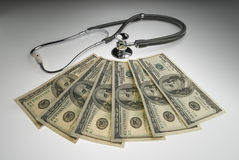 The cost of healthcare. Money and stethoscope to illustrate the cost of health care Stock Images