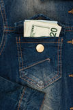 Money sticking out of jeans pocket Royalty Free Stock Photography