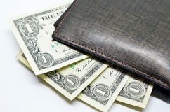 Money sticking out of a leather wallet Royalty Free Stock Image