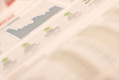 Money and stock selection in newspaper Royalty Free Stock Photos