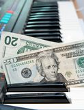 Money Stuck In Electric Organ Keyboard Royalty Free Stock Images