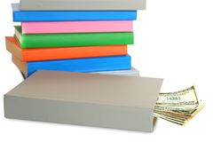 Money for student. Stack of different color books. Money in the book. Shallow DOF Royalty Free Stock Photography