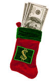 Money Stuffed in a Christmas Stocking. Christmas stocking holding 100 dollar bills.  Isolated on white.  Vertical studio shot Royalty Free Stock Photos