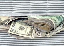 Money Stuffed in Between the Mattresses Royalty Free Stock Photography
