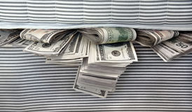 Money Stuffed in Between the Mattresses Royalty Free Stock Photo