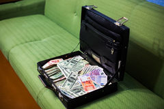 Money in a suitcase Royalty Free Stock Images