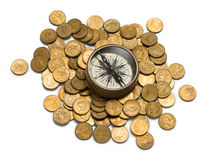 Money Superannuation Management Compass. A compass on australian one dollar coins isolated on white royalty free stock image