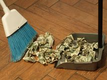 Money sweep 5. Photo of  a broom and dust pan sweeping up money Stock Image